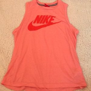 light pink and red sleeveless NIKE tee